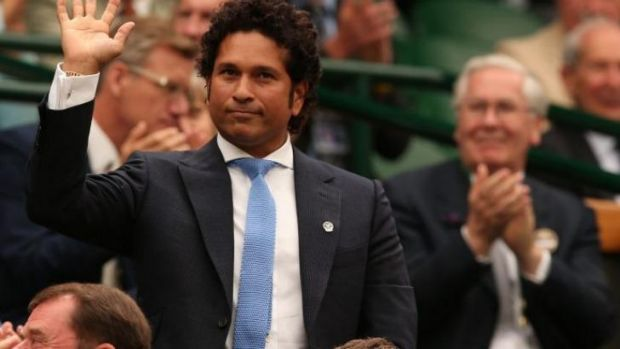 Sachin Tendulkar acknowledges the applause from the crowd at Wimbledon.