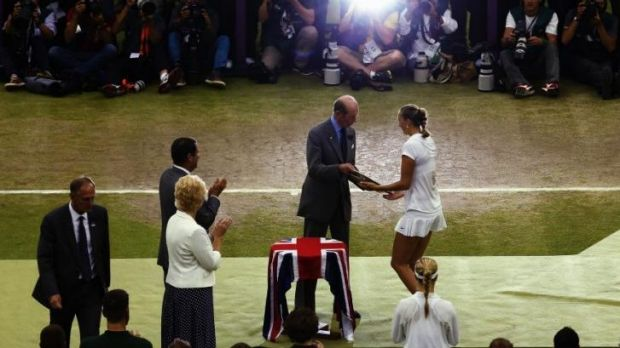 Petra Kvitova of Czech Republic receives the Venus Rosewater Dish trophy from Prince Edward, Duke of Kent.