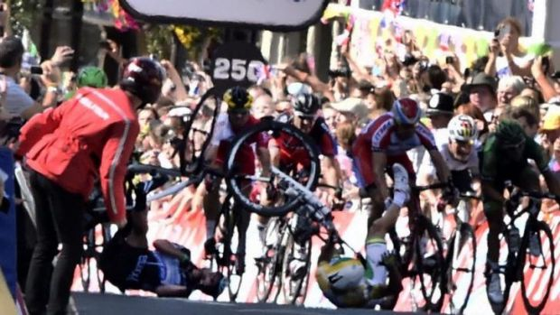 The fall: Mark Cavendish brings down Simon Gerrans.
