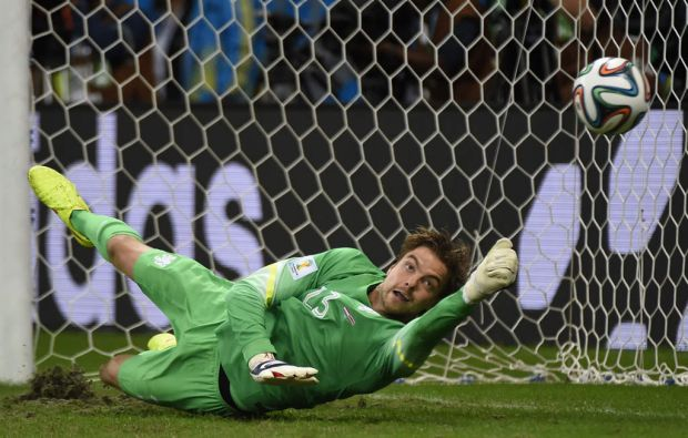 Netherlands' goalkeeper Tim Krul saves a penalty during the penalty shoot-out of the quarter-final football match ...