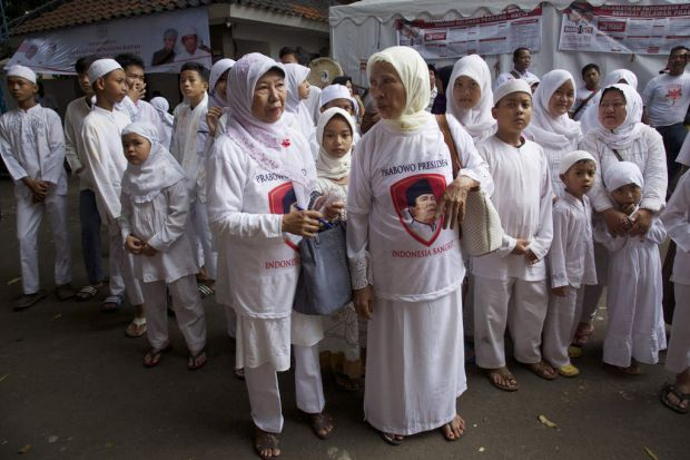 Indonesian women from an islamic group gather at the campaign headquarters of  Presidential candidate Prabowo Subianto ...