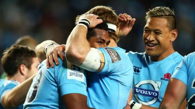 Massive win: Waratahs players swamp Taqele Naiyaravoro after his try against the Highlanders.