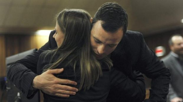 Oscar Pistorius is greeted by his sister Aimee Pistorius in court in Pretoria on July 2. The re-enactment footage of the ...