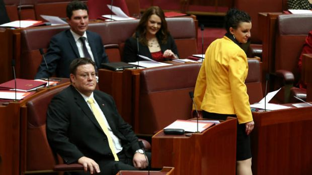 PUP Senator Jacqui Lambie takes her seat along with colleague Glenn Lazarus, right, and, behind, Greens senators Scott ...