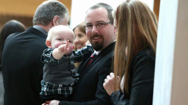 Motoring Enthusiast Senator Ricky Muir with his son at the senators' swearing-in reception.