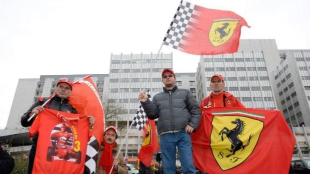 An AFP filephoto shows fans of Michael Schumacher in front of the Grenoble University Hospital Centre in January this ...