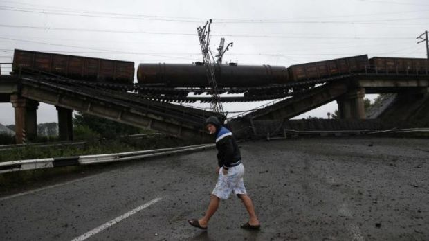 A destroyed railroad bridge on a  road leading to Donetsk.
