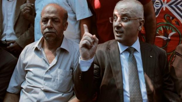 Mohammed's father, Hussein Abu Khadeir, left, with Palestinian Prime Minister Rami Hamdallah.