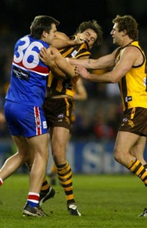 A brusing encounter with Hawk opponent Nathan Thompson in 2004