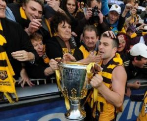 Happy days with the premiership cup and a Norm Smith Medal.
