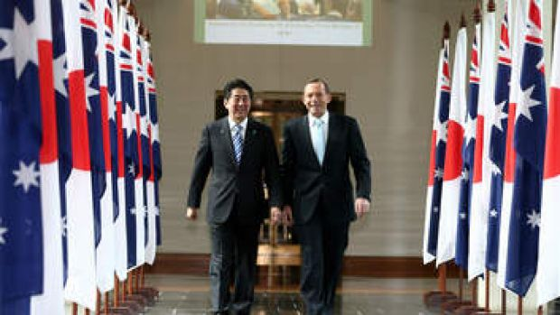 In lockstep: Japanese Prime Minister Shinzo Abe and Prime Minister Tony Abbott leave the House of Representatives after ...