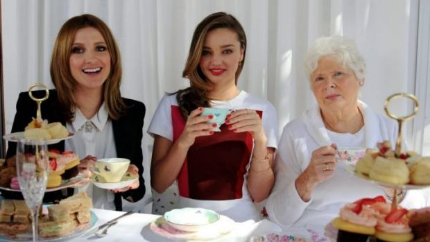 Family affair: Miranda Kerr, centre, and her grandmother Anna Kerr at high tea with Kate Waterhouse.