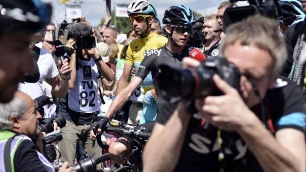 Crowded: Britain's Chris Froome and Italy's Vincenzo Nibali wait at the departure village in Cambridge prior to the ...