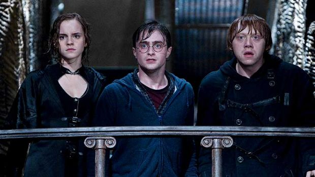 Hermione Granger, Harry Potter and Ron Weasley portrayed by Emma Watson, Daniel Radcliffe and Rupert Grint in <i>Harry ...
