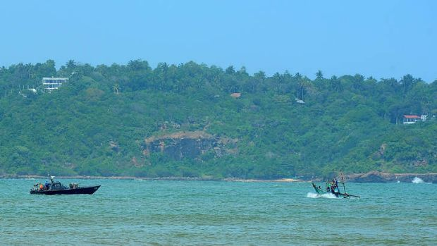 A Sri Lankan navy boat (left) on patrol in the southern port of Galle.