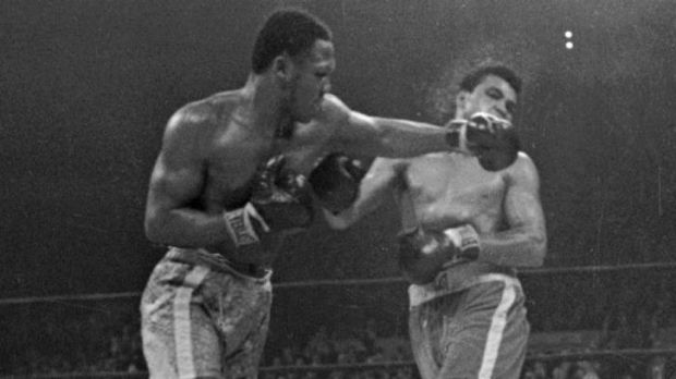 Ali takes one of Frazier's fame left hooks.