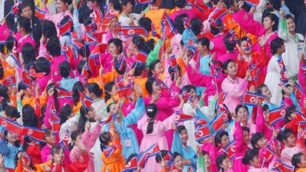 Cheerleaders from North Korea in traditional dress cheer at the opening cermony for a previous Asian Games in 2002, in ...