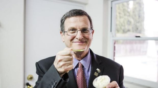 Shmuel Ben-Shmuel, the Israeli ambassador, tries the hummus-flavoured icecream.
