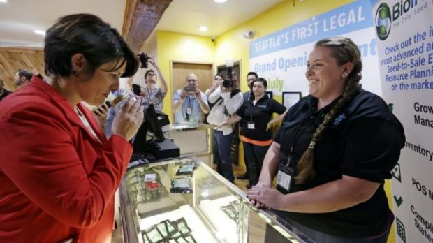 Alison Holcomb, criminal justice director at the Washington state branch of the American Civil Liberties Union, sniffs a ...