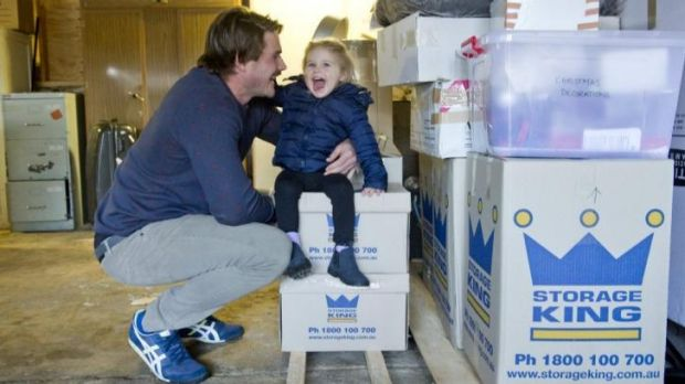 Brumbies captain Ben Mowen with his daughter Eleanor. The Mowens are almost packed before their move to France.