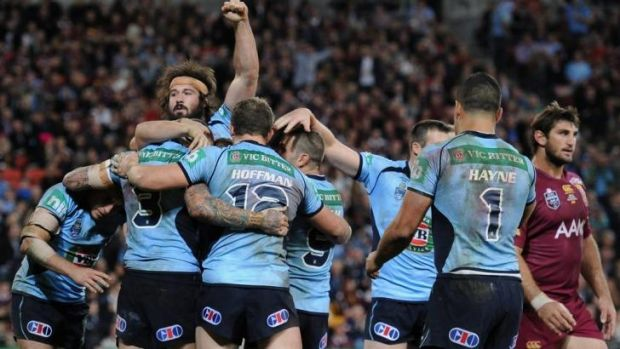 New breed: Front-rower Aaron Woods celebrates after Josh Dugan's try.