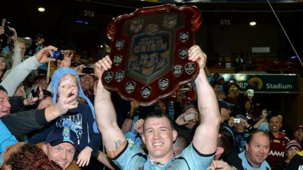 Proud moment: Paul Gallen lifts the State of Origin shield.