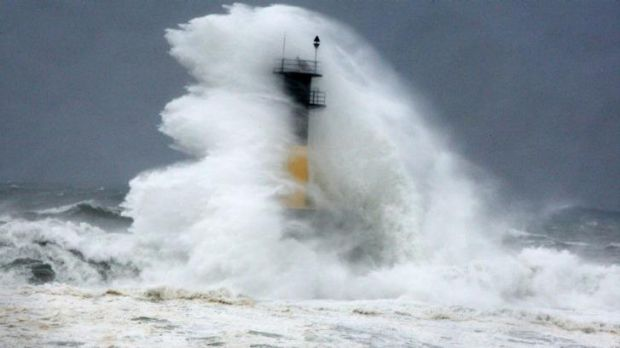 A hugeh wave hits a lighthouse as Typhoon Neoguri approaches the Korean Peninsula in Seogwipo on Jeju Island, South Korea