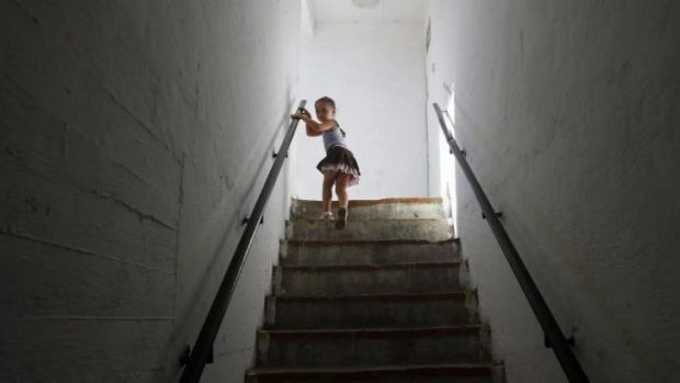 A girl leaves a bomb shelter after a siren warning of incoming rockets was sounded in the southern Israeli city of ...
