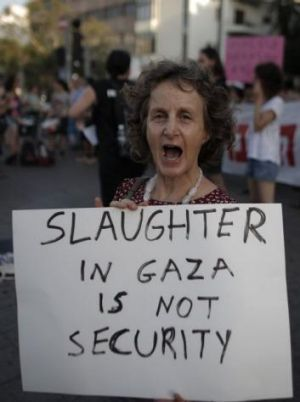 An Israeli activist carries a placard protesting against the bombardment of Gaza in the Israeli city of Tel Aviv.