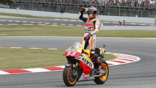 Unstoppable: Marc Marquez does a celebratory lap after his winning the Catalunya GP last month.