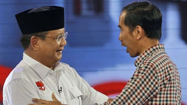 Indonesian election: Joko Widodo, right, shakes hands with his opponent Prabowo Subianto.
