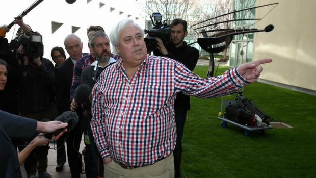 Look, over there: Clive Palmer addresses the media.