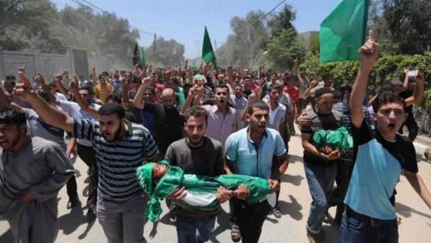 Palestinians carry the body of three-year-old Mohammed Mnassrah during his funeral.