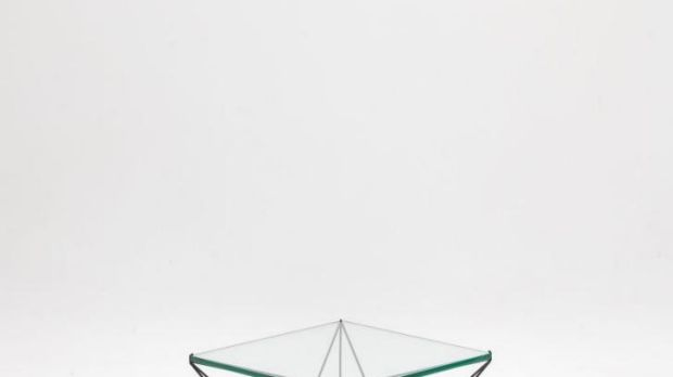 Clement Meadmore glass and steel coffee table.