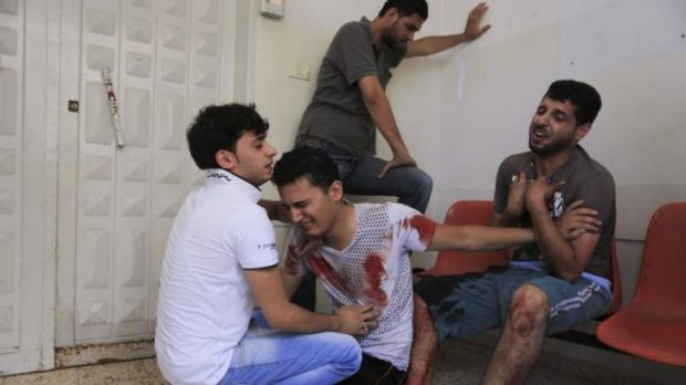 Relatives of a man reportedly killed by an Israeli air strike grieve at Gaza's Shifa Hospital.