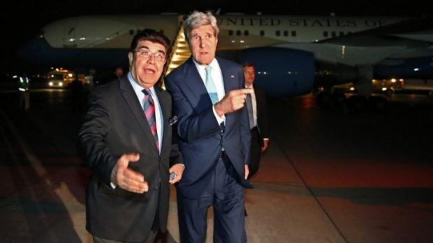 This way?: US Secretary of State John Kerry (right) with the Afghan foreign ministry's chief of protocol, Hamid Siddiq, ...
