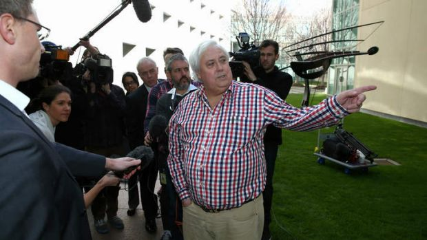 Palmer United Party leader Clive Palmer addresses the media in the Senate courtyard at Parliament House in Canberra on ...