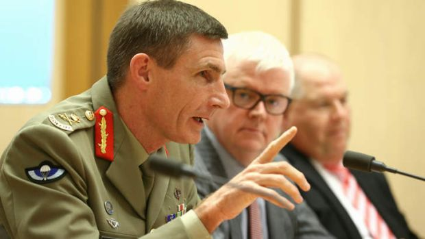 Lieutenant-General Angus Campbell, Mark Cormack, deputy secretary Immigration status resolution group and Ken Douglas, ...