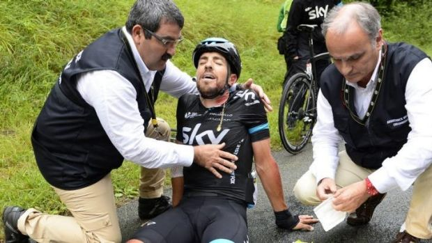 Spain's Xabier Zandio receives medical assistance after a fall during the sixth stage of the Tour de France between ...