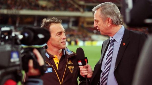Hawthorn coach Alastair Clarkson is interviewed by Dennis Cometti of Channel Seven before the game.