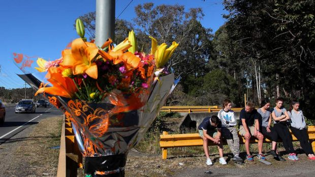 Shocked: Young friends gather at the crash site of Philip Vassallo on Andrews Road in Penrith.