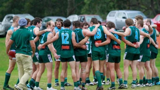 All for one: Ben Lavars (No. 2) and Geelong Amateur players in a recent game.