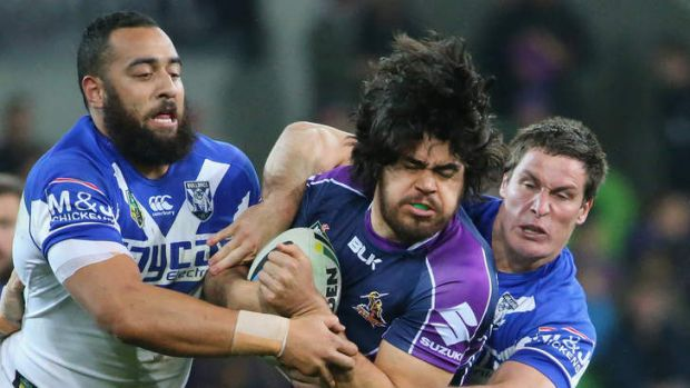 Storm forward Tohu Harris is tackled by the Canterbury Bulldogs at AAMI Park.
