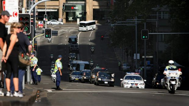 Behind the scenes: Dick Cheney's motorcade driving through Sydney at the end of his visit, the day Adam Grills was injured.