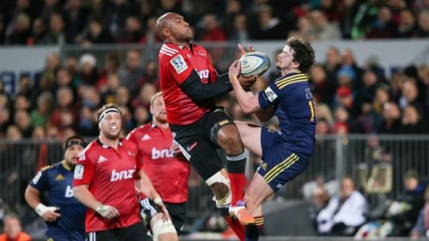 Strong contribution: Crusaders winger Nemani Nadolo clashes with Richard Buckman in Christchurch.