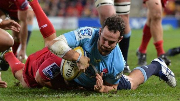 Five points, thank you: Jono Lance scrambles over for the Waratahs against the Reds.