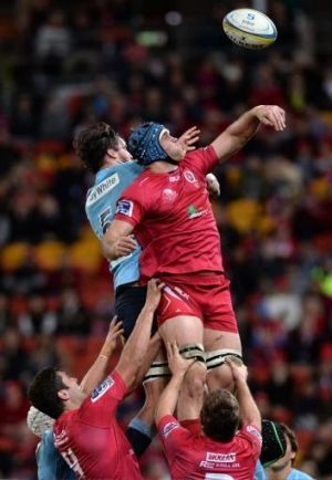 Aerial battle: The Waratahs' Kane Douglas and James Horwill of the Reds contest a lineout during Saturday night's game.