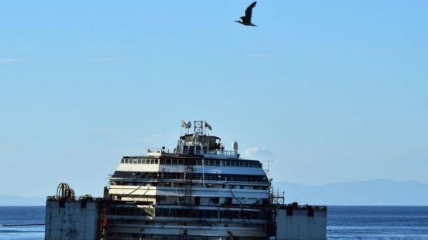 The Costa Concordia is resting on an underwater platform, but this week it is scheduled to be raised and a refloat attempted.
