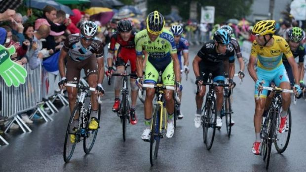 Under pressure: Alberto Contador (c) launches his attack with Vincenzo Nibali (R) and Richie Porte (2nd R) ready to respond.
