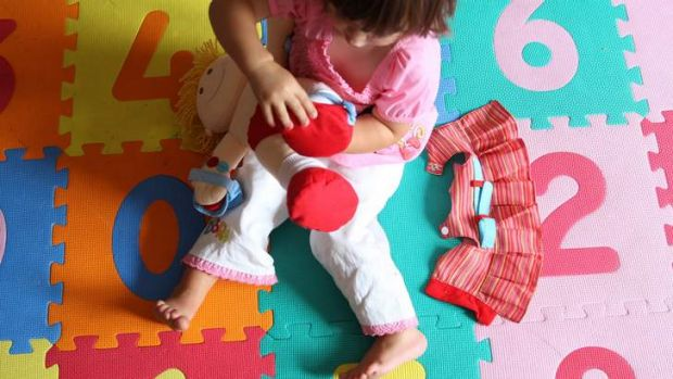 System under pressure: Labor is urging the government to enforce childcare guidelines that prioritise working parents ...
